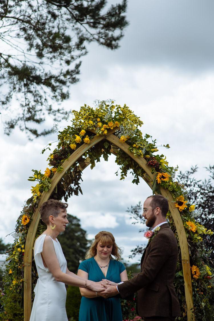 DIY Ceremony Bride Groom Yellow Wildflower Floral Arch Seasonal Alternative Hippy Farm Field Garden Wedding | Homegrown Community Eclectic Rural Yorkshire Wedding https://toastofleeds.co.uk/