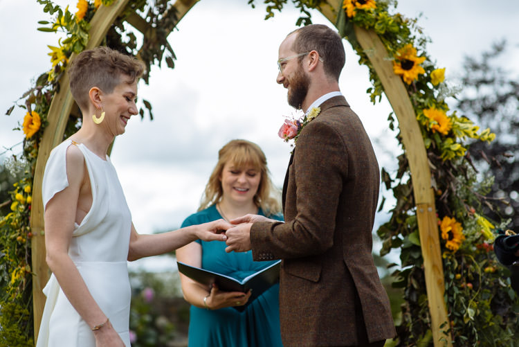 DIY Ceremony Bride Groom Ring Yellow Wildflower Floral Arch Seasonal Alternative Hippy Farm Field Garden Wedding | Homegrown Community Eclectic Rural Yorkshire Wedding https://toastofleeds.co.uk/