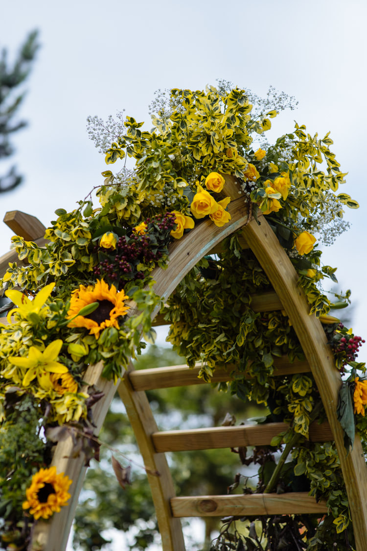 DIY Ceremony Arch Floral Yellow Sunflower Seasonal Alternative Hippy Farm Field Garden Wedding | Homegrown Community Eclectic Rural Yorkshire Wedding https://toastofleeds.co.uk/