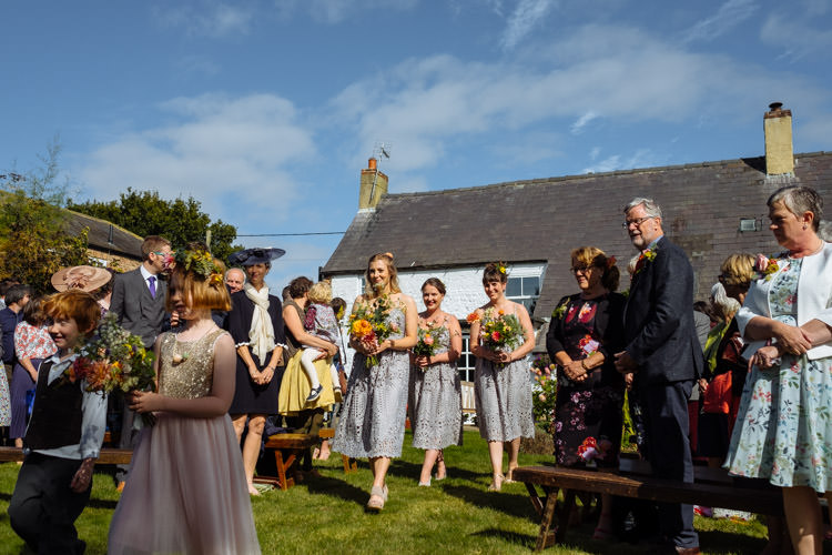 DIY Ceremony Aisle Bridesmaids Yellow Bouquets Seasonal Alternative Hippy Farm Field Garden Wedding | Homegrown Community Eclectic Rural Yorkshire Wedding https://toastofleeds.co.uk/
