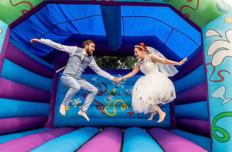 Bouncy Castle Mismatched Colourful Wildflower Meadow Wedding Hush Venues Norfolk http://lighteningphotography.co.uk/
