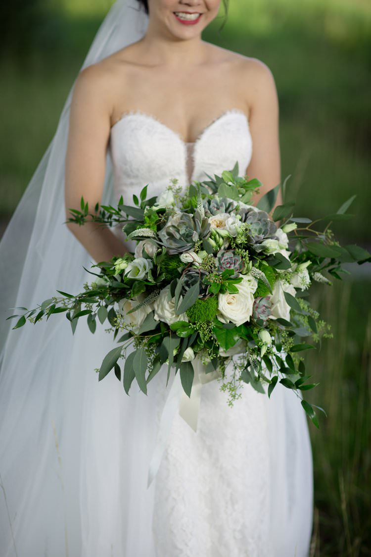 Outdoor Field Festival Rustic Hot Air Balloon Bride White Greenery Bouquet | Black Tie Carnival Wedding Hot Air Balloon http://www.makingthemoment.com/