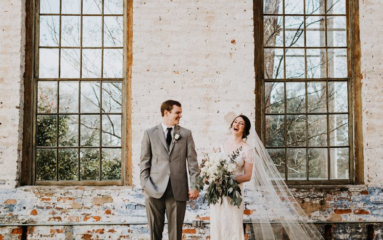 City Urban Georgia Engine Room Exposed Bricks Bride Groom Embrace First Look Green White Bouquet | Bohemian Industrial Oxblood Wedding https://www.lunaleephotos.com/
