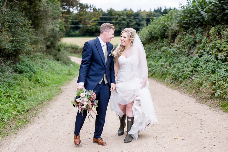Bride Bridal Lace Strapless Dress Tulle Veil Bouquet Multicoloured Pheasant Feather Groom Blue Tails Waistcoat Three Piece Suit Wellies Autumn Countryside Family Farm Wedding Dorset http://www.lydiastampsphotography.com/