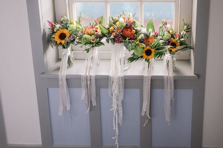 Flowers Bouquet Bride Bridal Yellow Red Sunflower Billy Ball Ribbons Colourful Indie London City Wedding Clissold House West Reservoir Centre https://www.murrayclarke.co.uk/