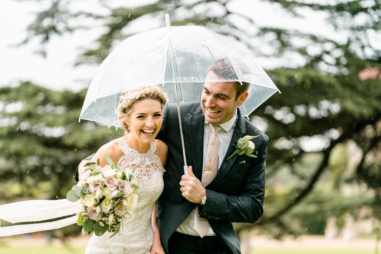 Lace Keyhole Neck Fitted Pronovias Dress Gown Bride Bridal Faux Flower Crown Veil Bouquet Ribbon Rain Clear Umbrella Groom Suit Reiss Bottle Green Nostalgic Honest British Loseley Park Wedding Surrey https://www.johnbarwoodphotography.co.uk/