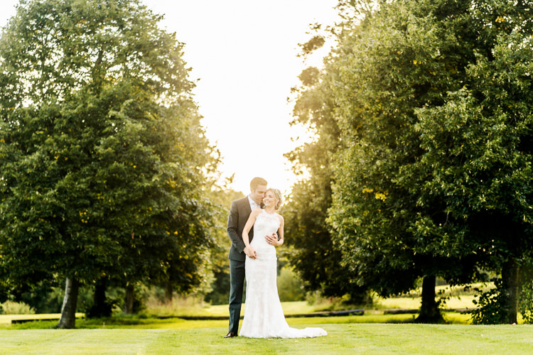 Lace Keyhole Neck Fitted Pronovias Dress Gown Bride Bridal Faux Flower Crown Veil Bouquet Ribbon Reiss Groom Suit Bottle Green Nostalgic Honest British Loseley Park Wedding Surrey https://www.johnbarwoodphotography.co.uk/
