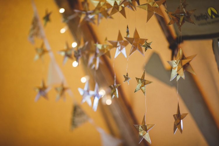 Hanging Gold Stars Relaxed Country Tipi Yellow Wedding Hampshire https://photography34.co.uk/