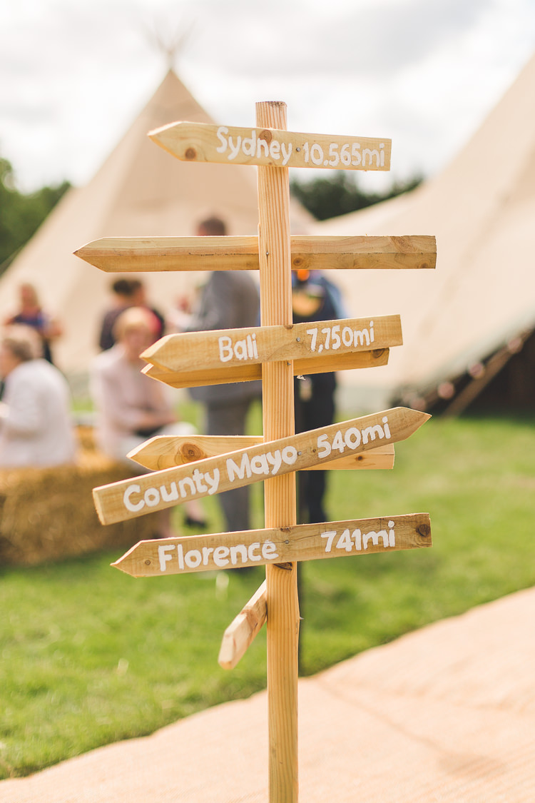 Signpost Wooden Sign Directions Colourful Outdoor Tipi Farm Wedding https://kirstymackenziephotography.co.uk/