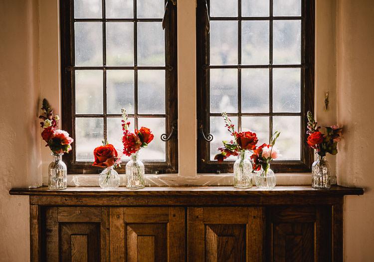 Glass Bottles Flowers Red Pink Roses Raucous Artistic Wintry Wedding Voewood Norfolk https://www.luisholden.com/