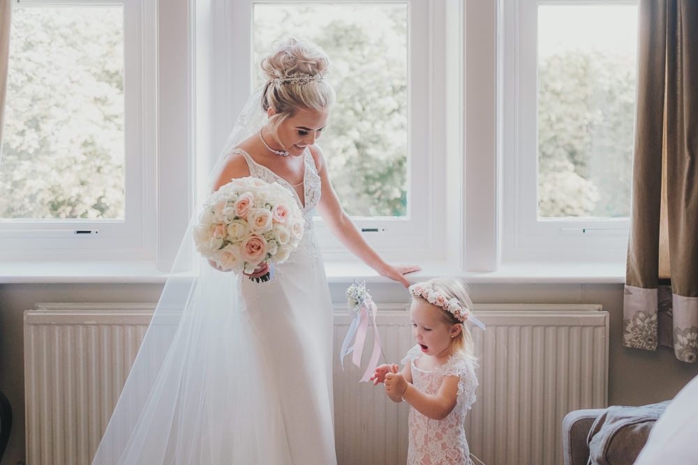 Happy Bride Bridal Prep Morning Hair Updo Classic Traditional Elegant Round White Rose Bouquet Pink Flower Girl | Ashfield House Wedding Kate McCarthy Photography