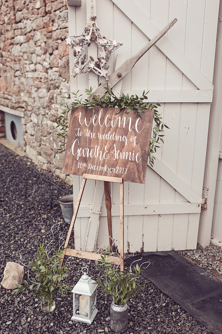 Hand Painted Personalised Sign Modern Calligraphy Rustic Welcome Sign Easel Greenery Foliage Magical Wonderland Askham Hall Wedding Winter Tiree Dawson Photography