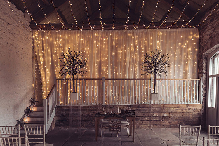 Ceremony Pea Fairy Light Backdrop Candles Magical Wonderland Askham Hall Wedding Winter Tiree Dawson Photography
