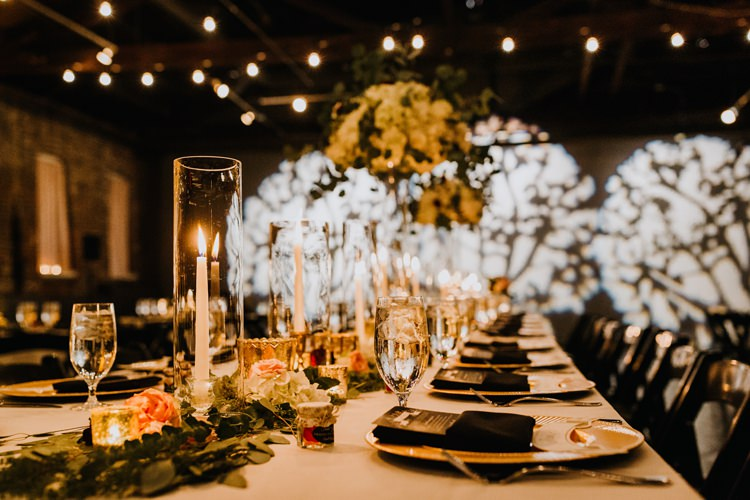 Warehouse Rustic Chic Refined Atlanta King Plow Wedding Table Black Chairs White Flowers Light Show | Boho Industrial Winter Wedding Lunalee Photography