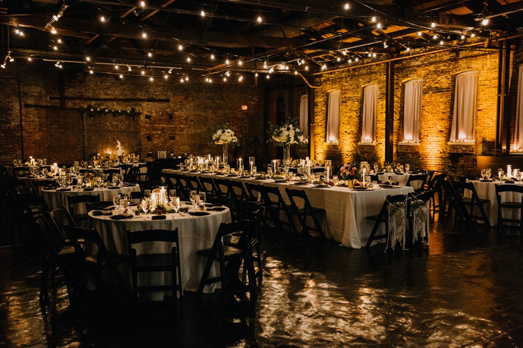 Warehouse Rustic Chic Refined Atlanta King Plow Wedding Table Black Chairs White Flowers Festoon Lights | Boho Industrial Winter Wedding Lunalee Photography