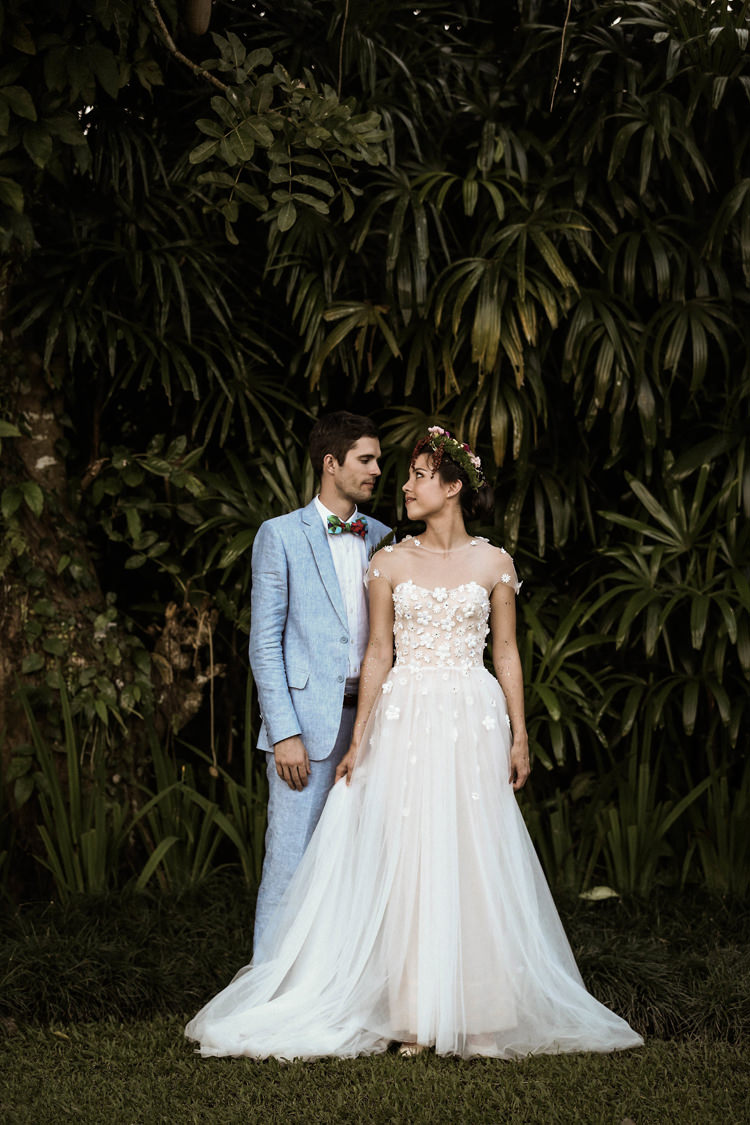 Outdoor Destination Luxury Adventure Ubud Foliage Bride Groom Floral Dress Blue Suit | Whimsical Exotic Tropical Jungle Wedding Bali http://www.cecilephotographybali.com/