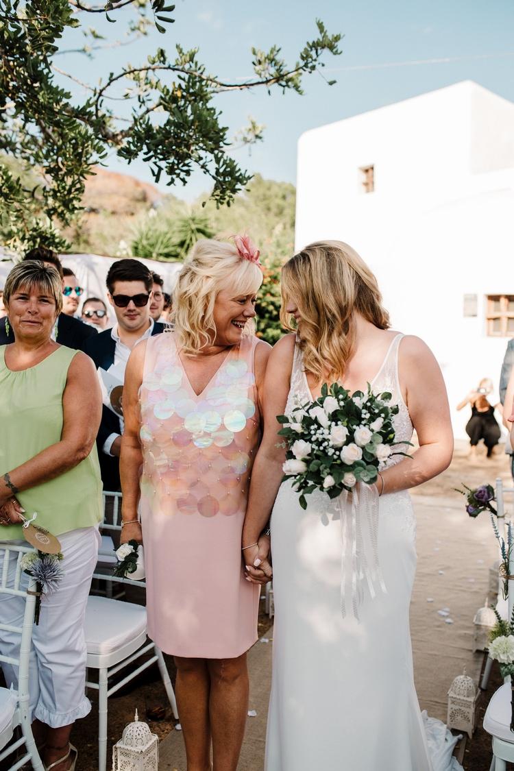 Spain Sun Outdoor Tropical Mediterranean Garden Villa Outdoor Ceremony Aisle Mother Bride | Ibiza Destination Wedding Amy Faith Photography