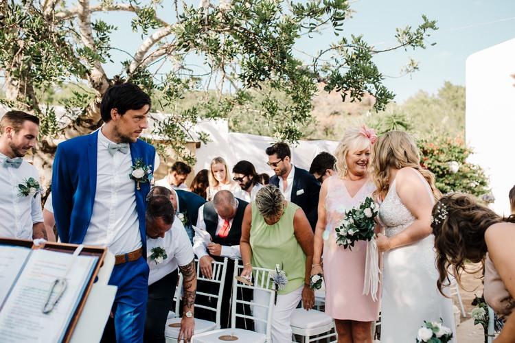 Spain Sun Outdoor Tropical Mediterranean Garden Villa Outdoor Ceremony Groom Mother Bride Aisle | Ibiza Destination Wedding Amy Faith Photography