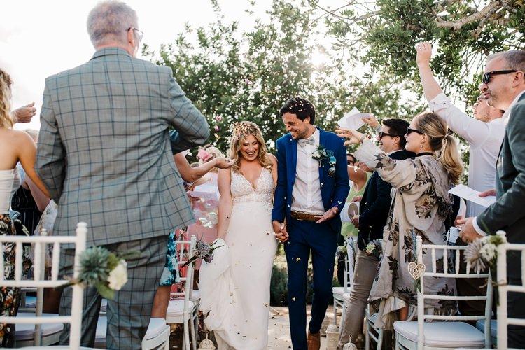Spain Sun Outdoor Tropical Mediterranean Garden Villa Outdoor Ceremony Bride Groom Aisle | Ibiza Destination Wedding Amy Faith Photography