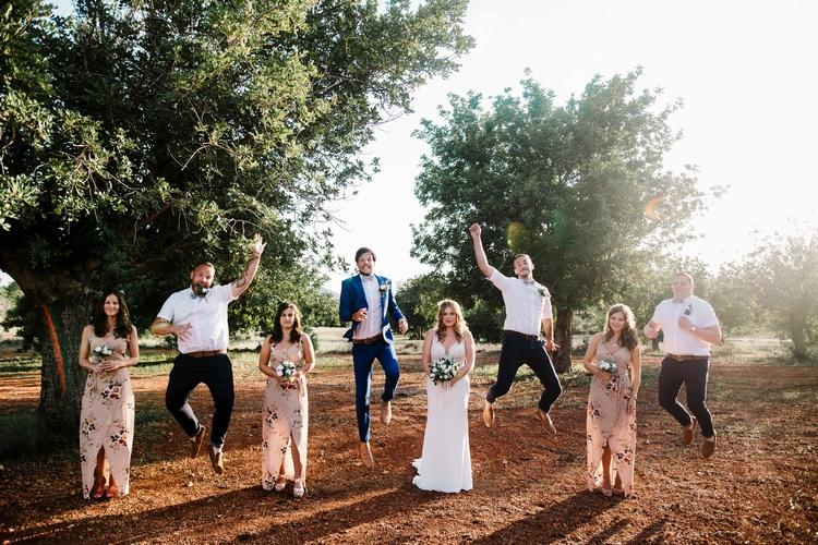 Spain Sun Outdoor Tropical Mediterranean Garden Villa Bride Bridesmaids Groom Groomsmen Jump | Ibiza Destination Wedding Amy Faith Photography