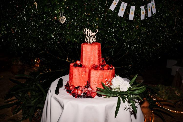 Spain Sun Outdoor Tropical Mediterranean Garden Villa Outdoor Reception Watermelon Cake | Ibiza Destination Wedding Amy Faith Photography