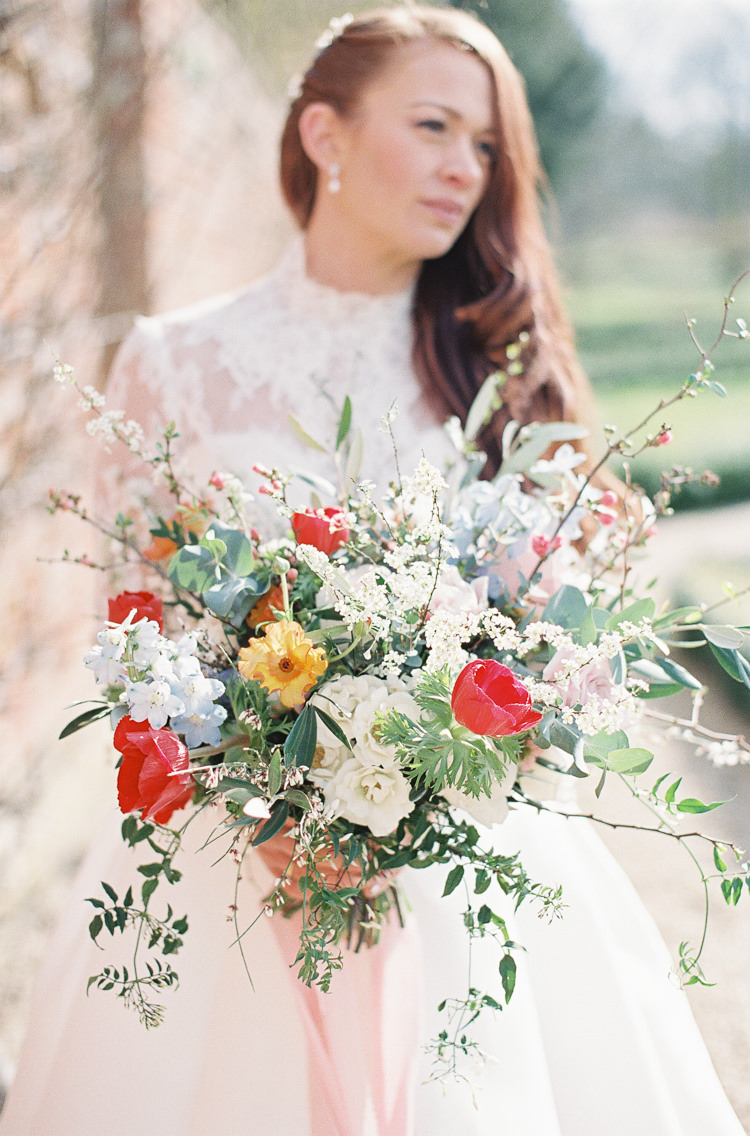 Flowers Poppies Anemones Delphiniums Ranunculus Snakeshead Fritillary Grape Hyacinth Colourful Bouquet Bride Bridal Whimsical Summer Chocolat Wedding Ideas Brympton House Liz Baker Fine Art Photography