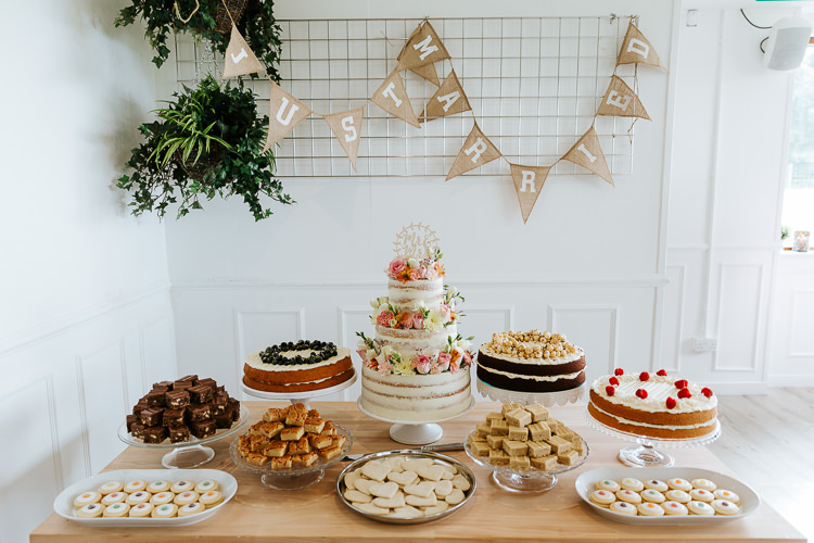 Cake Table Treats Sweets Dessert Hessian Bunting Pretty Pastel Floral Village Hall Wedding Struve Photography