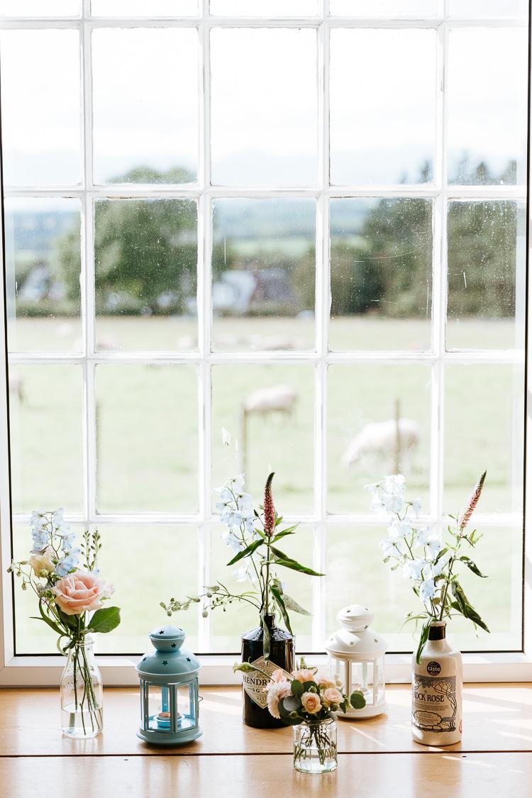 Gin Bottle Flowers Pink Blue Windowsill Pretty Pastel Floral Village Hall Wedding Struve Photography