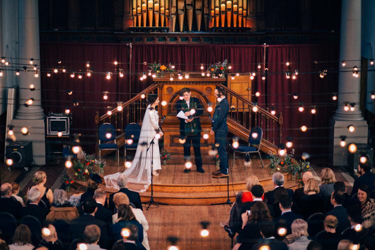 Bride Bridal Dress Gown Vintage Silk 1940s Reiss Groom Blue Ceremony Festoon Lighting Round Chapel London Wedding Nikki van der Molen Photography