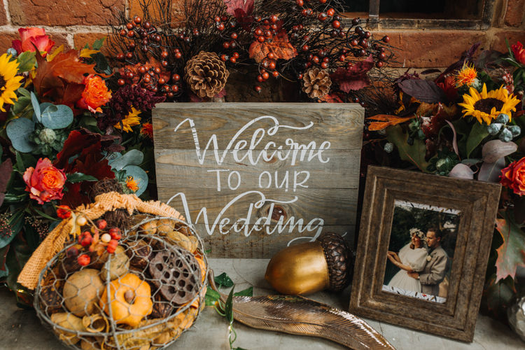 Wooden Welcome Sign Table Multicoloured Colourful Autumnal Flowers Photographs Shustoke Farm Barns Wedding Ellie Grace Photography