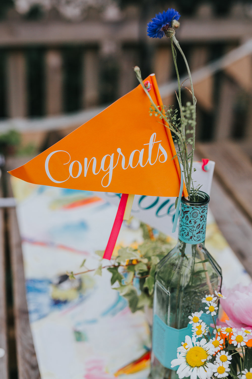 Bottle Jar Flowers Congrats Banner Flag Table Decor Colourful Bright Summer Pub Wedding Charlotte Razzell Photography