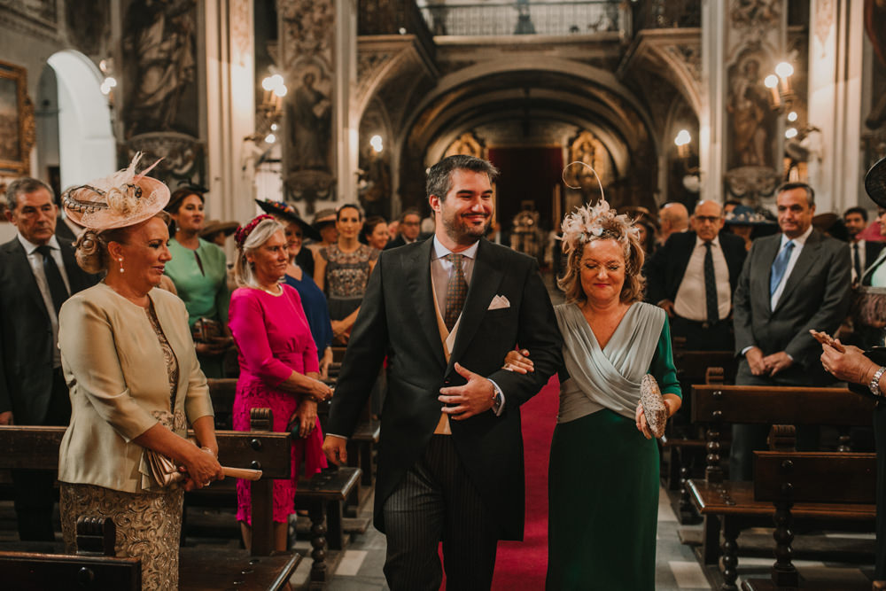 Outdoor Seville Destination Baroque Church Aisle Ceremony Groom | Colorful and Heartfelt Wedding in Spain Boda&Films