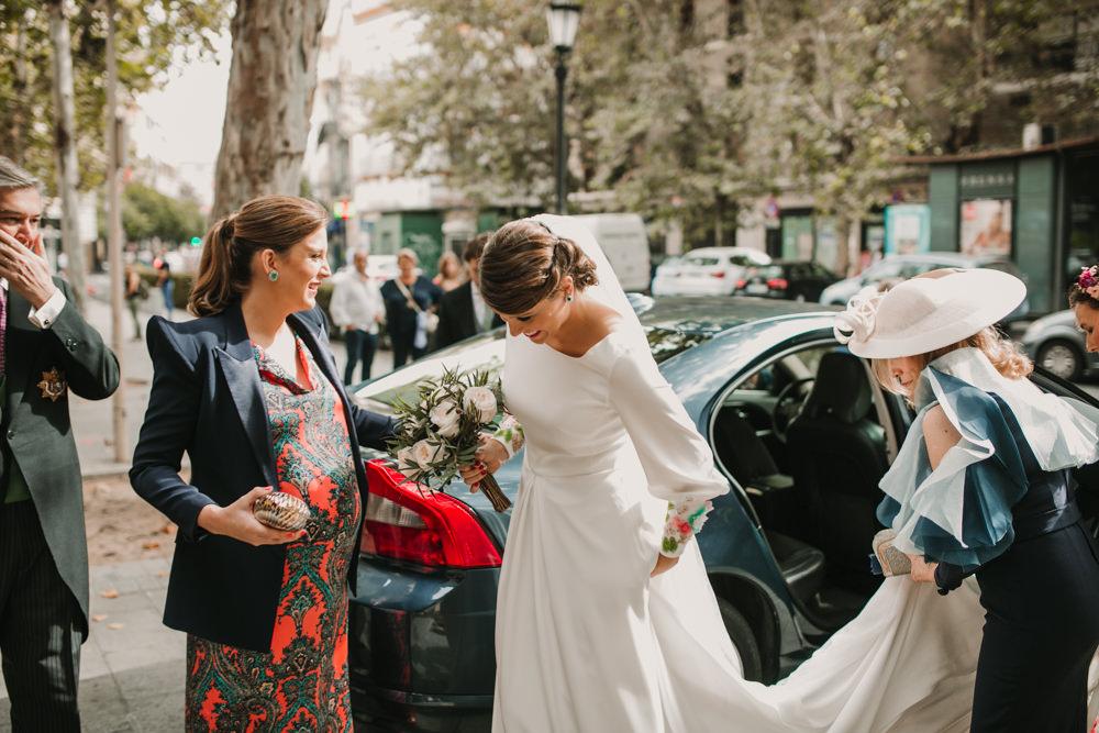 Outdoor Seville Destination Baroque Church Ceremony Bride Car | Colorful and Heartfelt Wedding in Spain Boda&Films