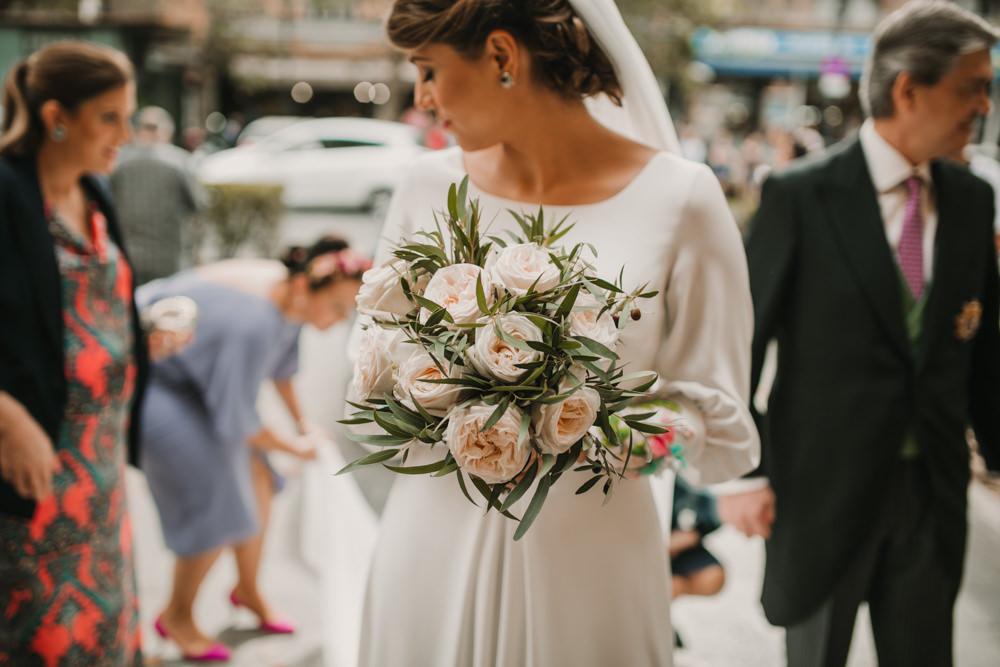 Outdoor Seville Destination Baroque Church Aisle Bride Green Blush Bouquet | Colorful and Heartfelt Wedding in Spain Boda&Films