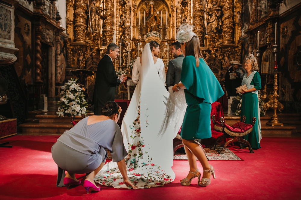 Outdoor Seville Destination Baroque Church Aisle Ceremony Bride Bridesmaids Veil | Colorful and Heartfelt Wedding in Spain Boda&Films