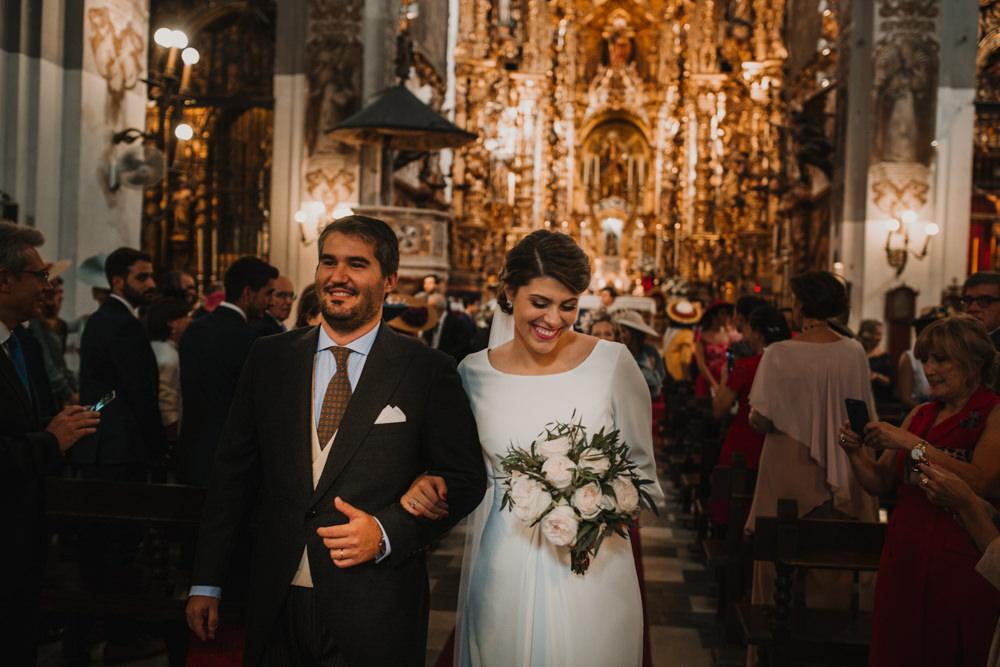 Outdoor Seville Destination Baroque Church Aisle Ceremony Bride Groom Blush Greenery Bouquet | Colorful and Heartfelt Wedding in Spain Boda&Films