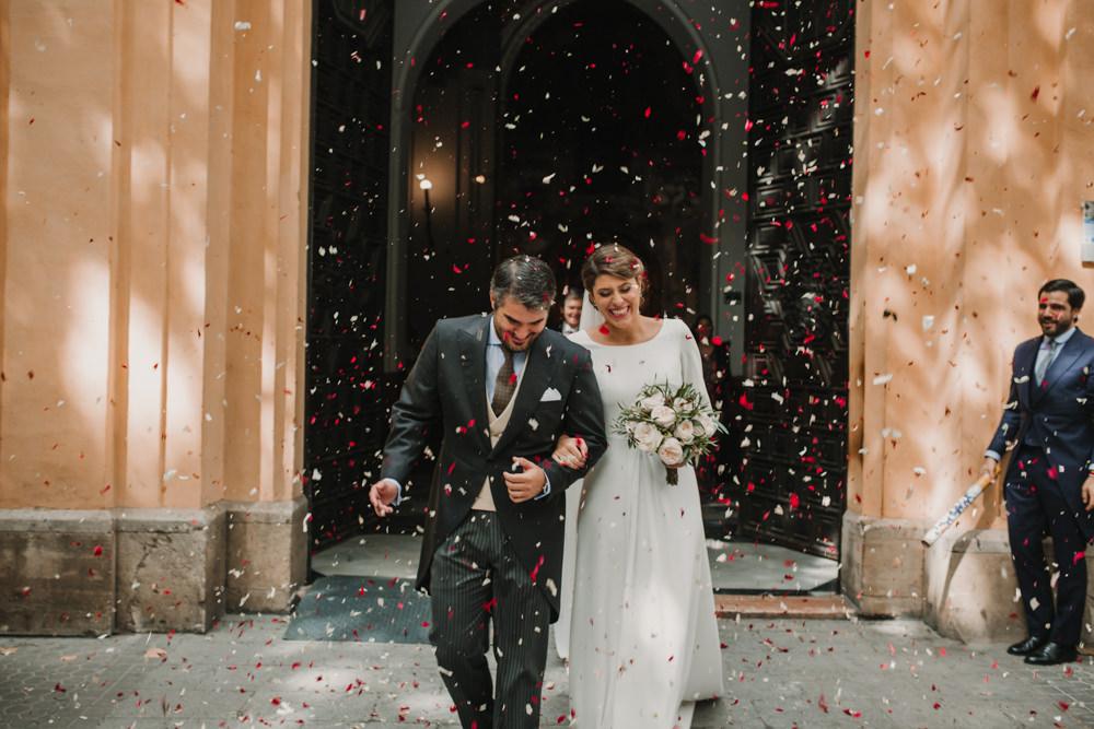 Outdoor Seville Destination Baroque Church Aisle Ceremony Bride Groom Confetti | Colorful and Heartfelt Wedding in Spain Boda&Films