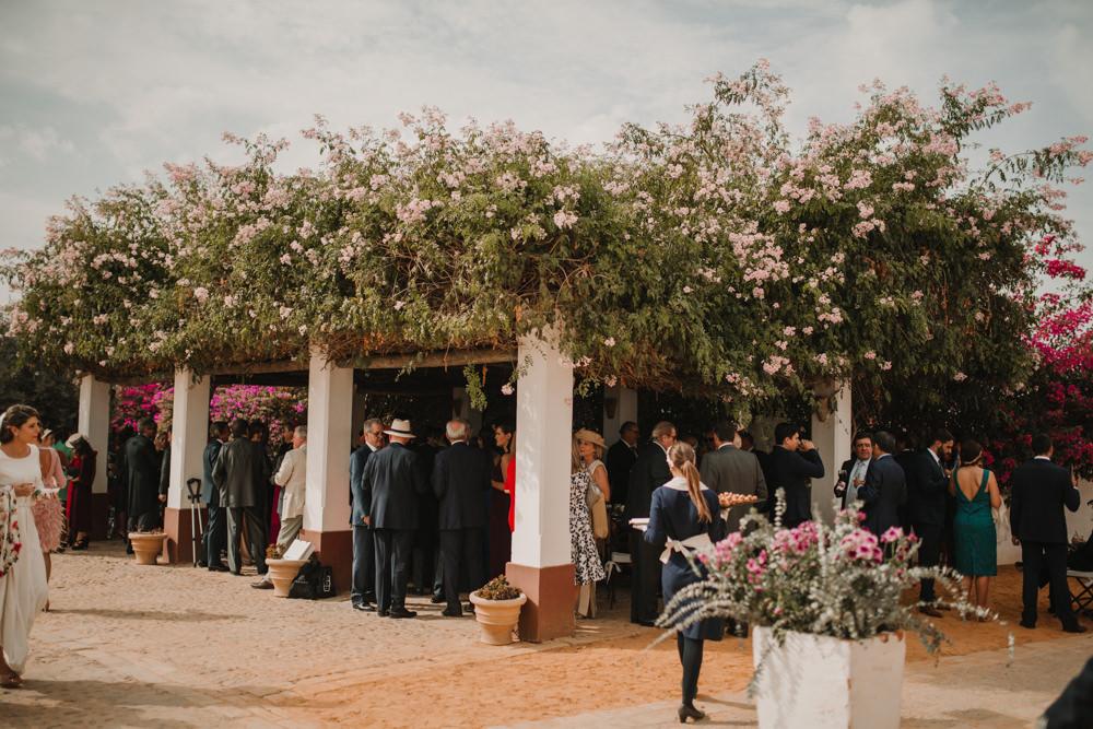 Outdoor Seville Destination Drinks Reception Villa Hacienda Floral | Colorful and Heartfelt Wedding in Spain Boda&Films