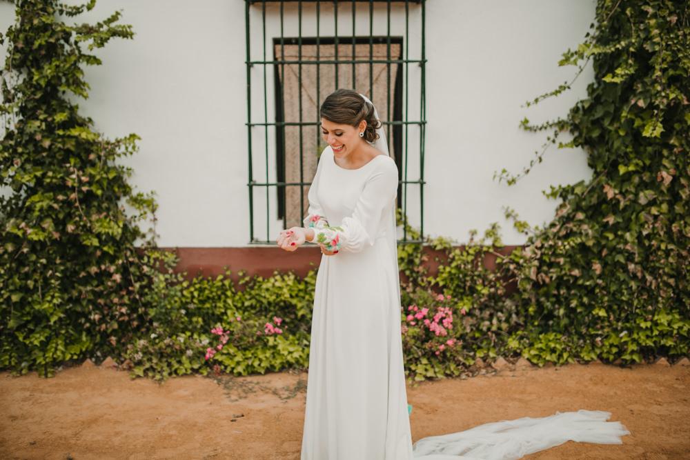 Outdoor Seville Destination Villa White Floral Flamenco Colorful Embellished White Dress | Colorful and Heartfelt Wedding in Spain Boda&Films