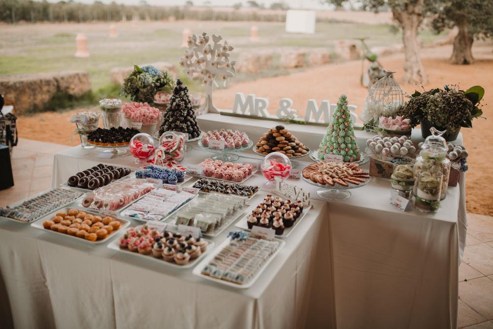 Outdoor Seville Destination Villa Hacienda Dessert Table | Colorful and Heartfelt Wedding in Spain Boda&Films