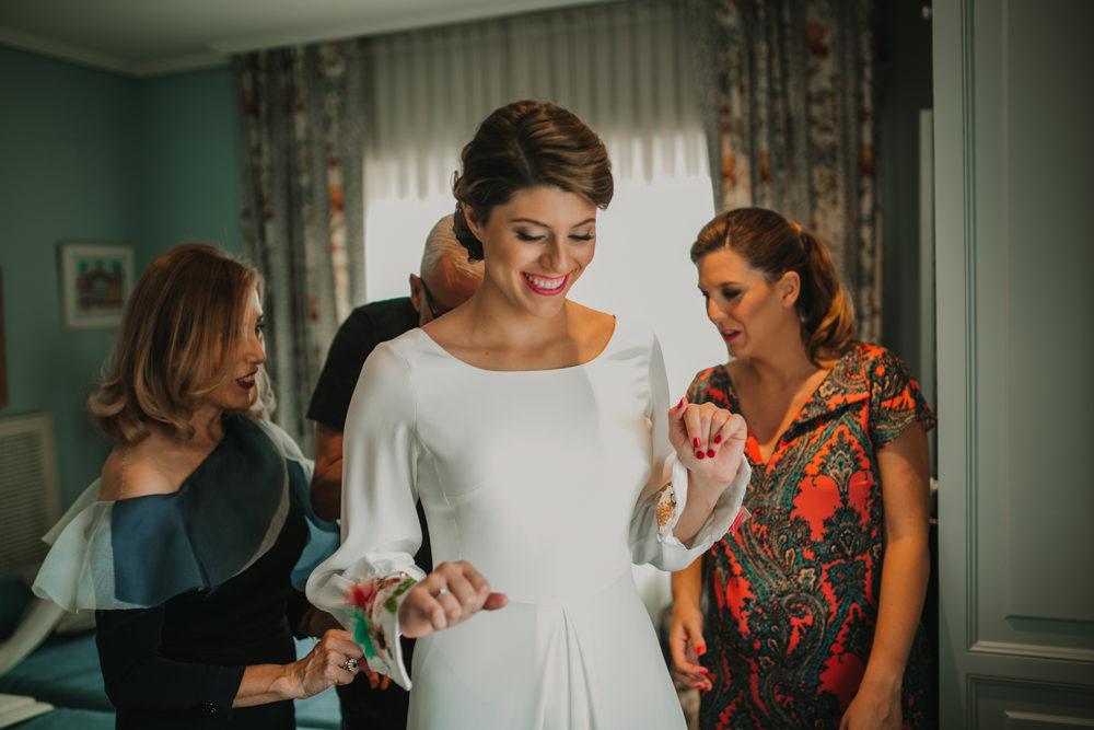 Outdoor Seville Destination Villa White Floral Flamenco Colorful Embellished White Dress Bride | Colorful and Heartfelt Wedding in Spain Boda&Films