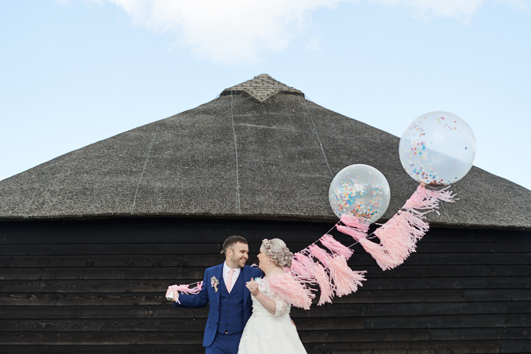 Bride Bridal A Line Sleeved Dress Gown Lace French Connection Groom Blue Waistcoat Three Piece Pink Tie Tasseled Confetti Balloons Wood Farm Barn Wedding Suffolk Faye Amare Photography