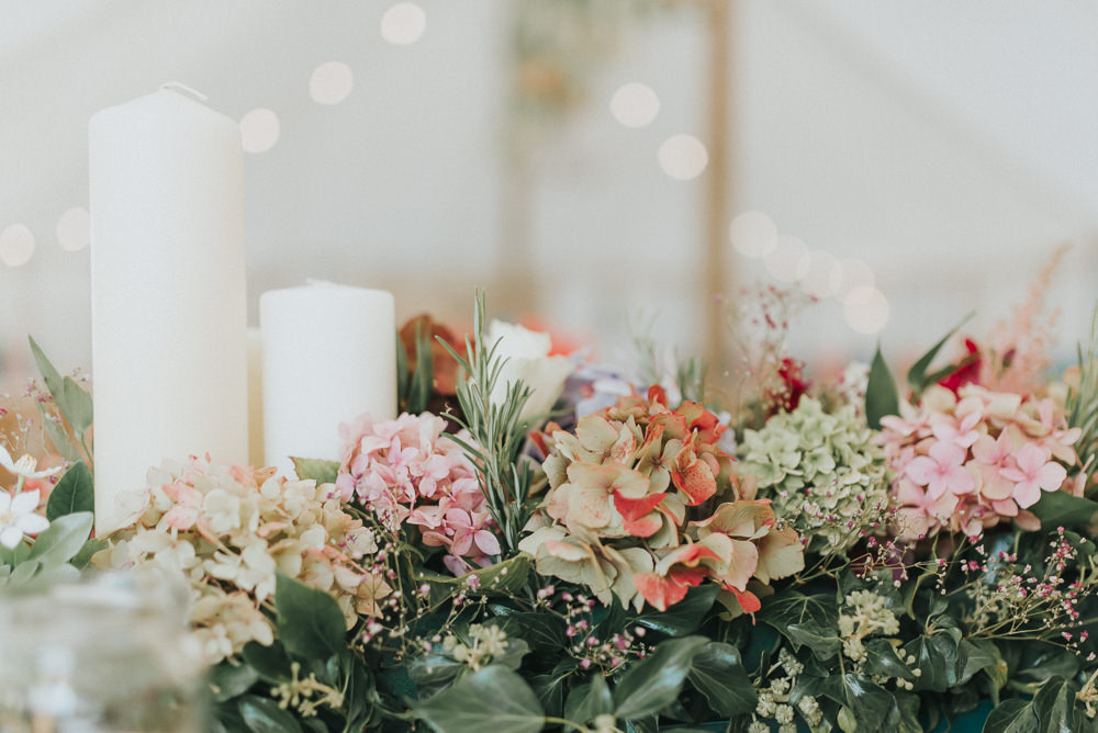Top Table Flower Arrangement Candles Hydrangeas Red Greenery Countryside Wedding Cotswolds Kate Waters Photography