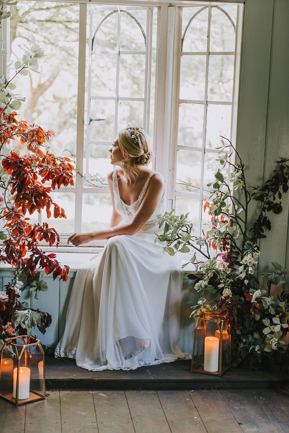 Secret Dresshouse Ethereal Bride Bridal Gown Storm Hurricane Lanterns Candles Leaf Foliage Flower Florals River Romance Wedding Ideas Mindy Coe Photography