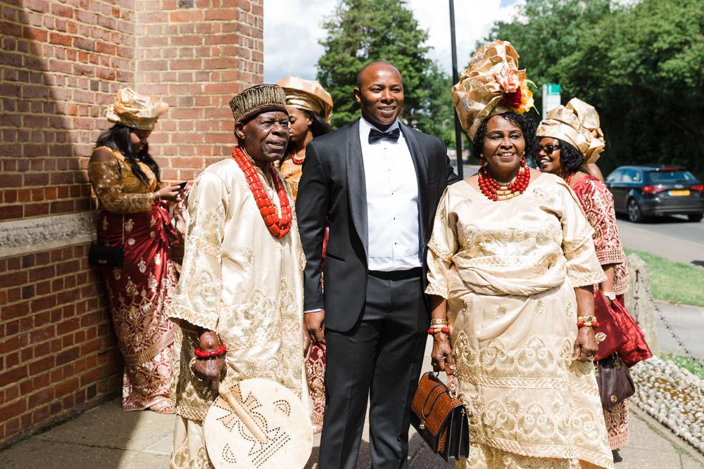 Hugo Boss Tuxedo Groom Nigerian Traditional Dress Gold Red Stoke Place Wedding Hannah McClune Photography