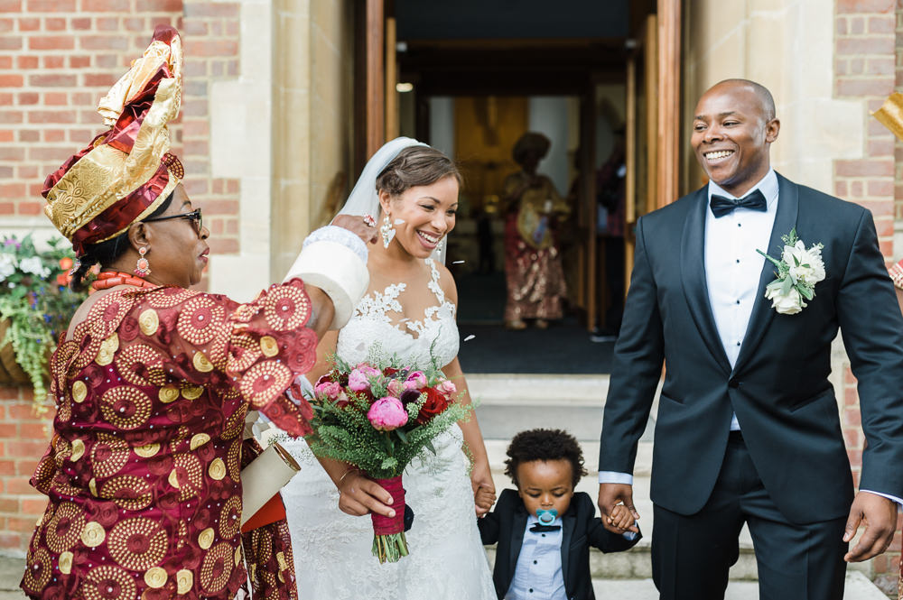 Bride Bridal La Sposa Fit & Flare Lace Dress Gown Floor Length Veil Pink Red Bouquet Hugo Boss Tuxedo Groom Traditional Nigerian Gold Red Stoke Place Wedding Hannah McClune Photography