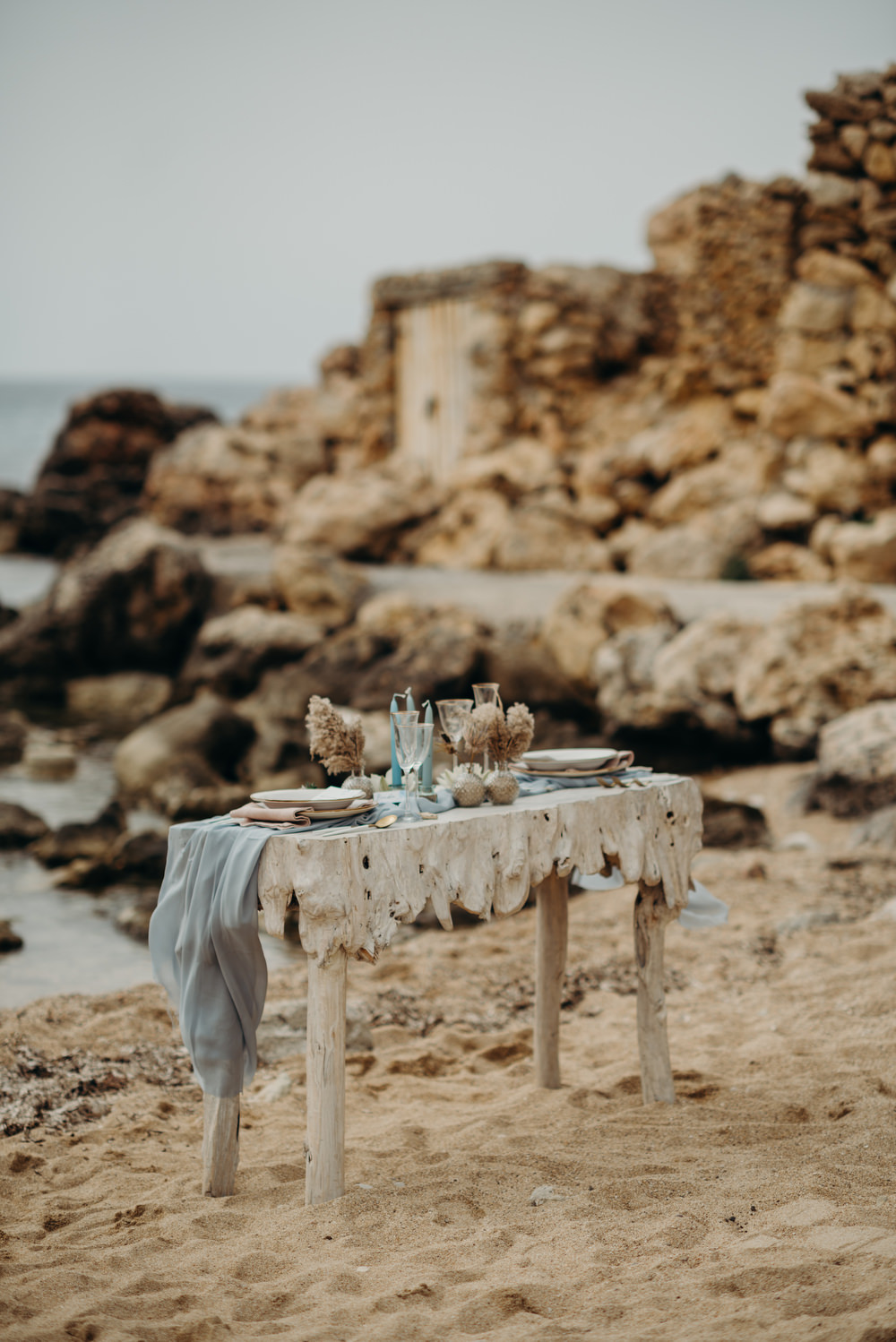 Outdoor Wild Nature Destination Spain Europe Coastal Beach Table Styling   Blue Ibiza Elopement Ideas and Surprise Proposal Serena Genovese Photography