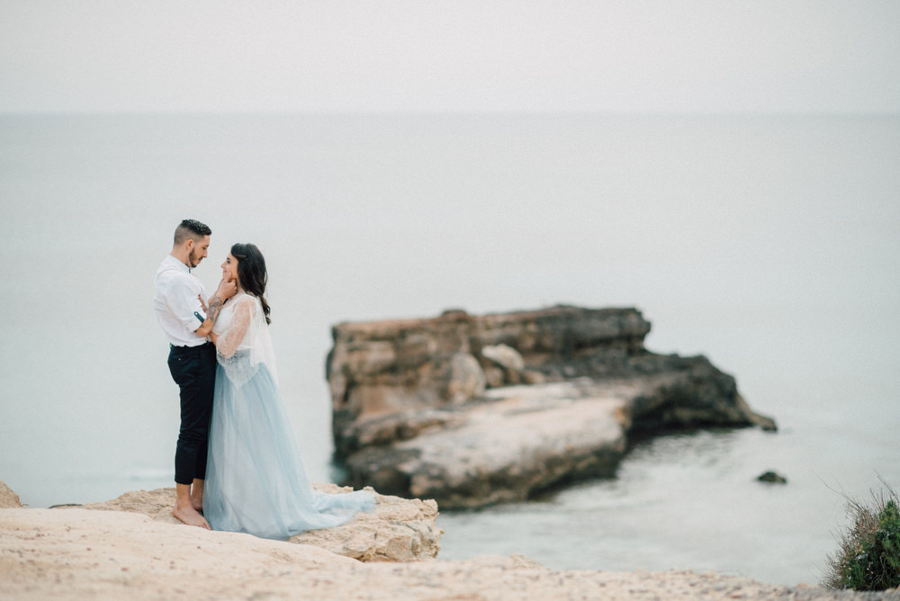 Outdoor Wild Nature Destination Spain Europe Beach Styled Shoot Groom Braces Bride Blue Gown Lace   Blue Ibiza Elopement Ideas and Surprise Proposal Serena Genovese Photography