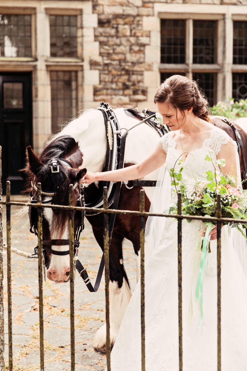 Bride Bridal Bespoke Dress Cape Sweetheart Neckline A Line Lace Wildflower Bouquet Horse Festival Wedding Mismatched Country Camilla Lucinda Photography