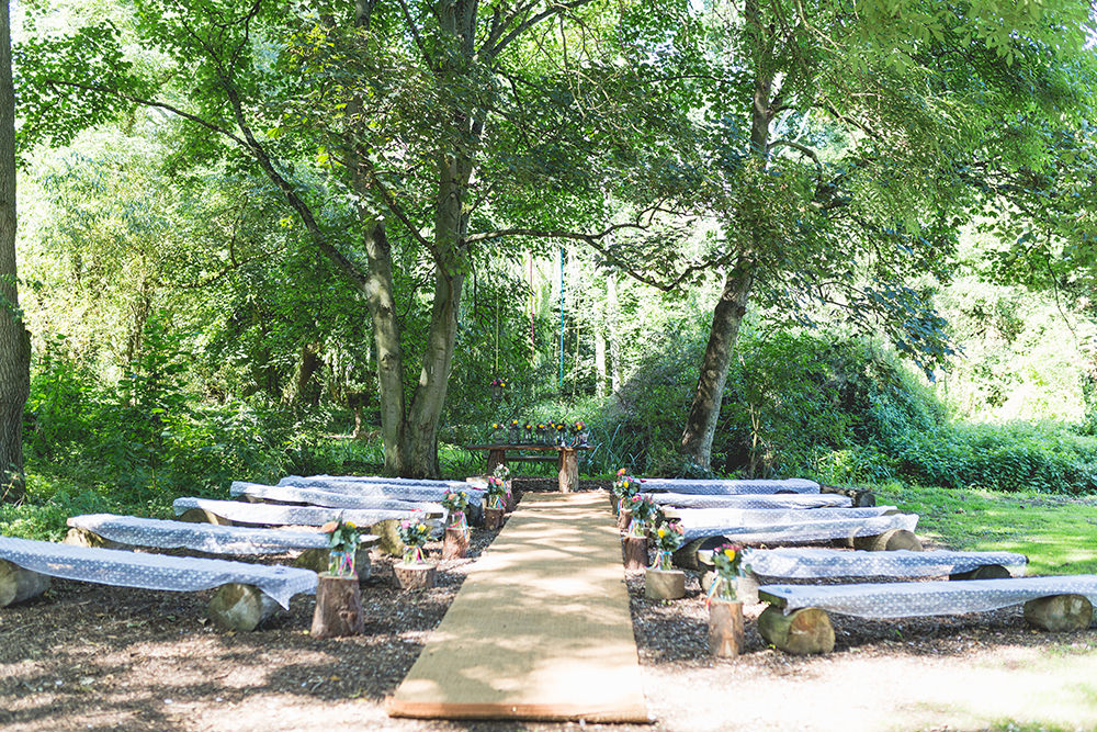 Outdoor Ceremony Wooden Benches Flowers Decor Aisle Hothorpe Hall Woodlands Wedding Lucy Long Photography